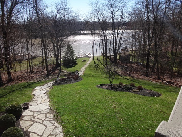 View of back yard, Lake & Dock